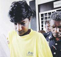 R. Narayanan being escorted from the Klang magistrate's court yesterday. — NST picture by Roslin Mat Tahir