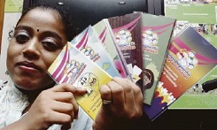 One of the participants, K. Pavithra showing off her Rakyat Guides booklets. — Picture by Hazreen Mohamad