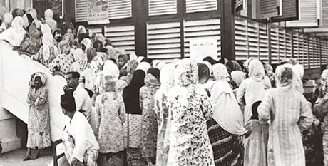 A large crowd of women elbowing their way to vote at a polling station in Mersing, Johor, during the first general elections in Malaya in 1955. The Alliance won 51 parliamentary seats out of 52.